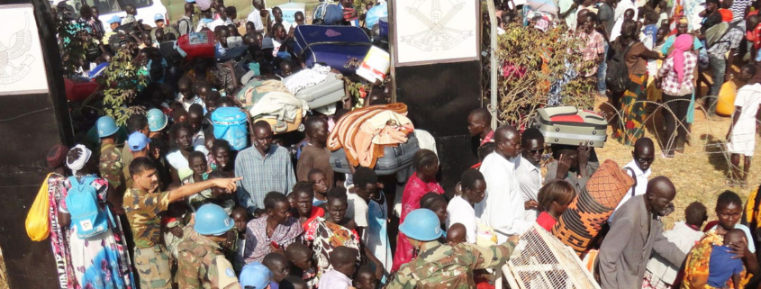 UNMISS peacekeepers assisting displaced civilians