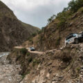 Afghanistan. WFP vehicles drive through a mountain pass